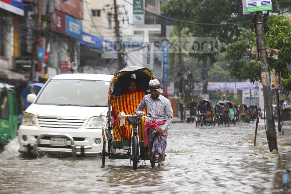 The streets at Jigatal in Dhaka go underwater after incessant rains. Residents say it takes hours for the the water to clear. This photo was taken on the Eid-ul-Fitr day on Wednesday. Photo: Mahmud Zaman Ovi