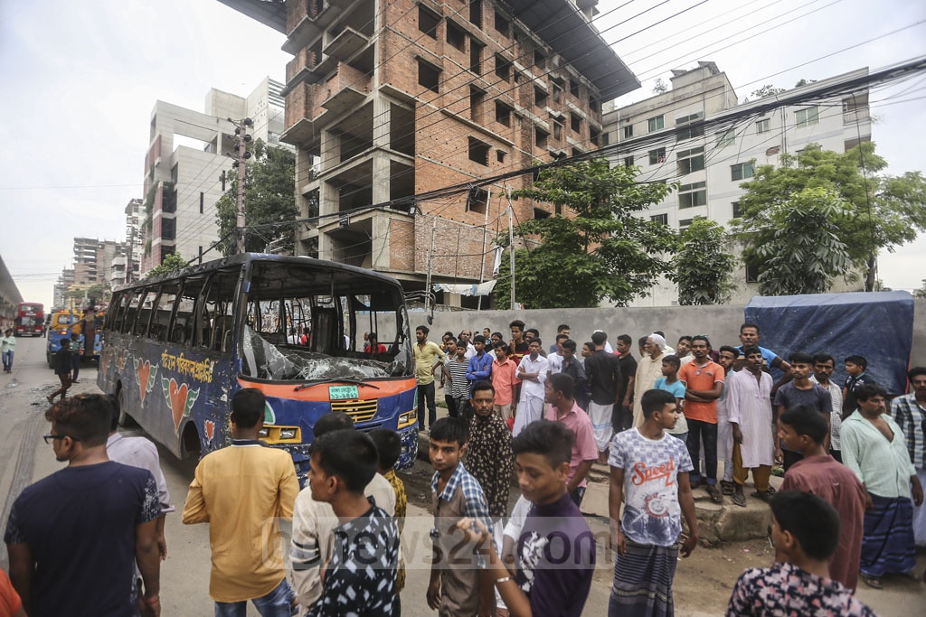 Two buses were being driven recklessly during an alleged race on the road near Bangla School in Dhaka's Mirpur Section No 11 on Thursday. They trampled an autorickshaw and a rickshaw. Photo: Mahmud Zaman Ovi