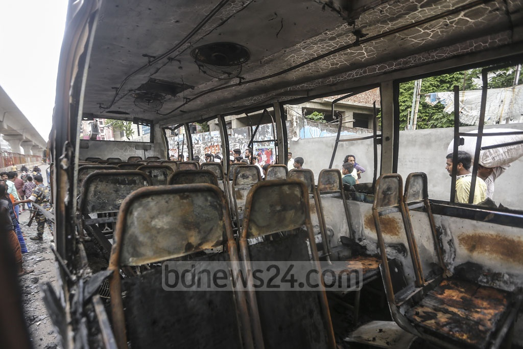 Agitated people vandalise and torch a bus of Paristhan Paribahan after an alleged race between two buses results in trampling of an autorickshaw and a rickshaw on the road near Bangla School in Dhaka's Mirpur Section No 11 on Thursday injuring three people. Photo: Mahmud Zaman Ovi
