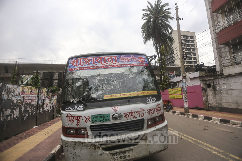 Agitated people vandalise a bus of Khajababa Paribahan after an alleged race between two buses results in the crushing of an autorickshaw and a rickshaw on the road near Bangla School in Dhaka's Mirpur Section No 11 on Thursday injuring three people. Photo: Mahmud Zaman Ovi