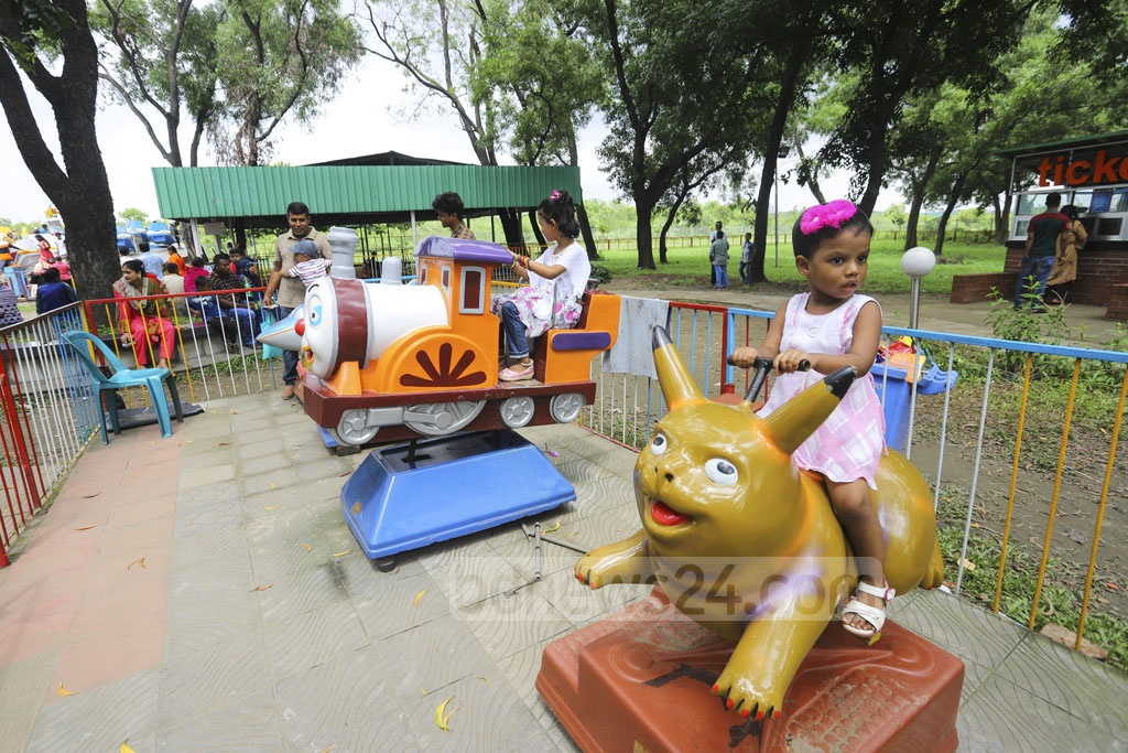 Children enjoying rides at the BAF Museum in Dhaka's Agargaon on Friday after Eid-ul-Fitr. Photo: Asif Mahmud Ove