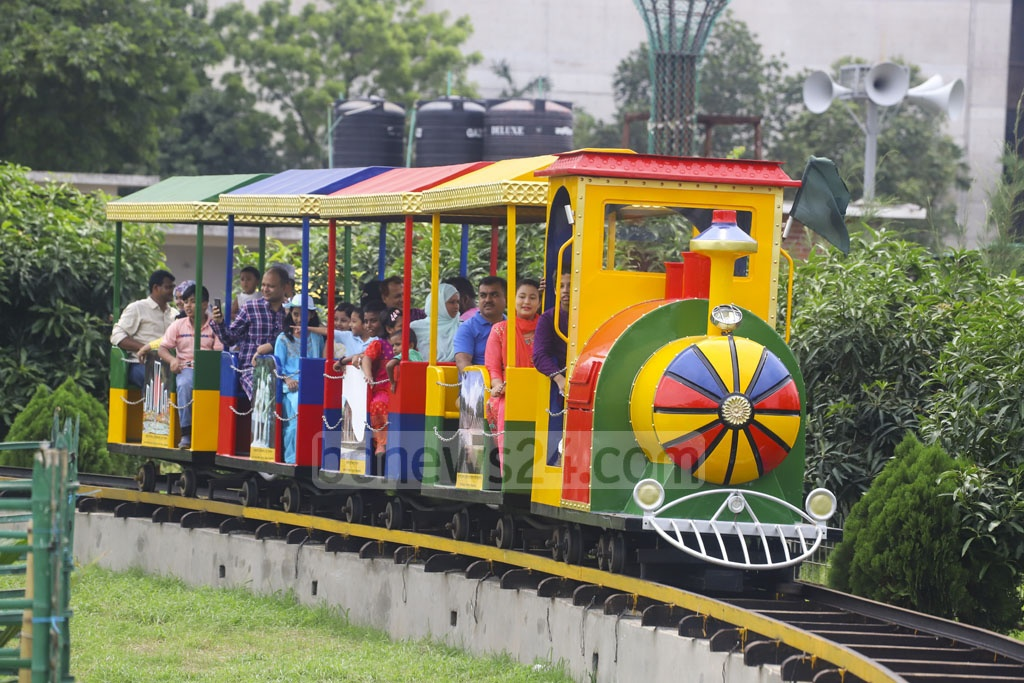 Adults along with children enjoying rides at the BAF Museum in Dhaka's Agargaon on Friday after Eid-ul-Fitr. Photo: Asif Mahmud Ove