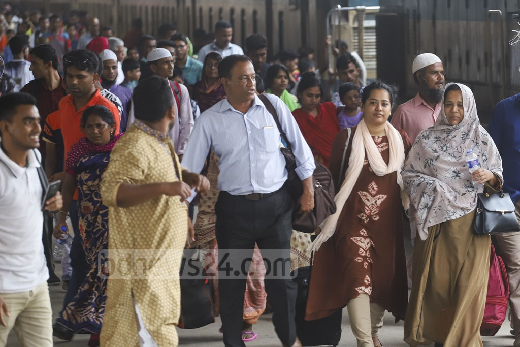 Residents have begun returning to Dhaka after spending the Eid-ul-Fitr holidays with friends and relatives back in their town and village homes. This photo was taken from Kamalapur Railway Station on Friday. Photo: Abdullah Al Momin