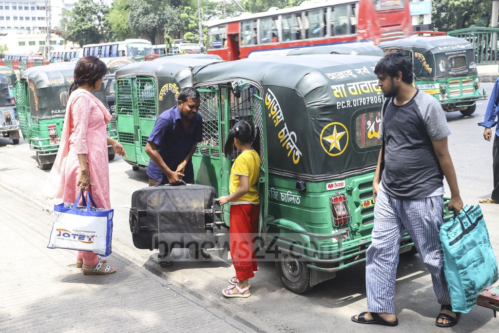 A family rents an autorickshaw in Mirpur near Gabtoli Bus Terminal as they return to Dhaka on Saturday after celebrating Eid-ul-Fitr with their relatives in their hometowns and villages. Photo: Asif Mahmud Ove