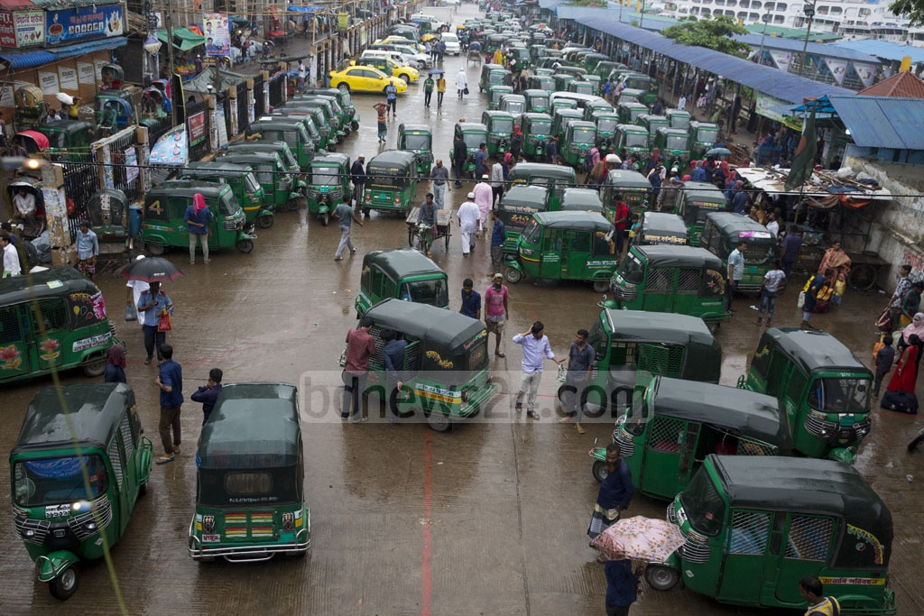 Rows of CNG autorickshaw wait outside Dhaka's Sadarghat Launch Terminal. But the majority of autorickshaw drivers sought fares for different destinations that are much higher than the normal rate. Photo: Mostafigur Rahman