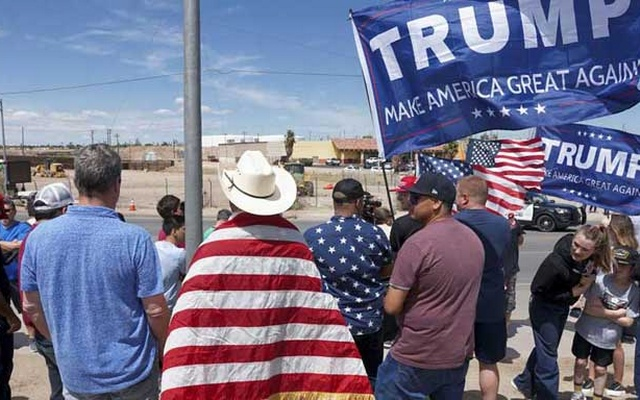 US-Mexico border: FILE PHOTO: Supporters of US President Donald Trump stand near the border during a rally as Trump visits the US-Mexico border in Calexico, California, US, Apr 5, 2019. REUTERS/Sandy Huffaker/File Photo