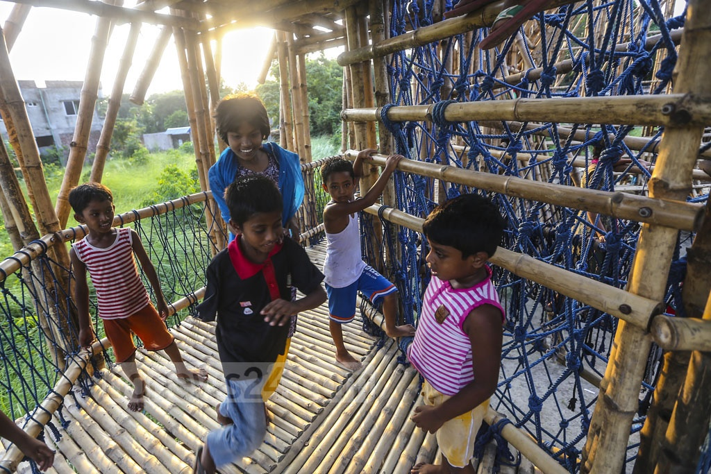 Children from both street and well-to-do families play together at a playhouse made with bamboo at Basila in Dhaka's Mohammadpur. Photo: Mahmud Zaman Ovi