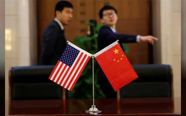 Chinese and US flags are set up for a signing ceremony during a visit by US Secretary of Transportation Elaine Chao at China's Ministry of Transport in Beijing, China Apr 27, 2018. REUTERS