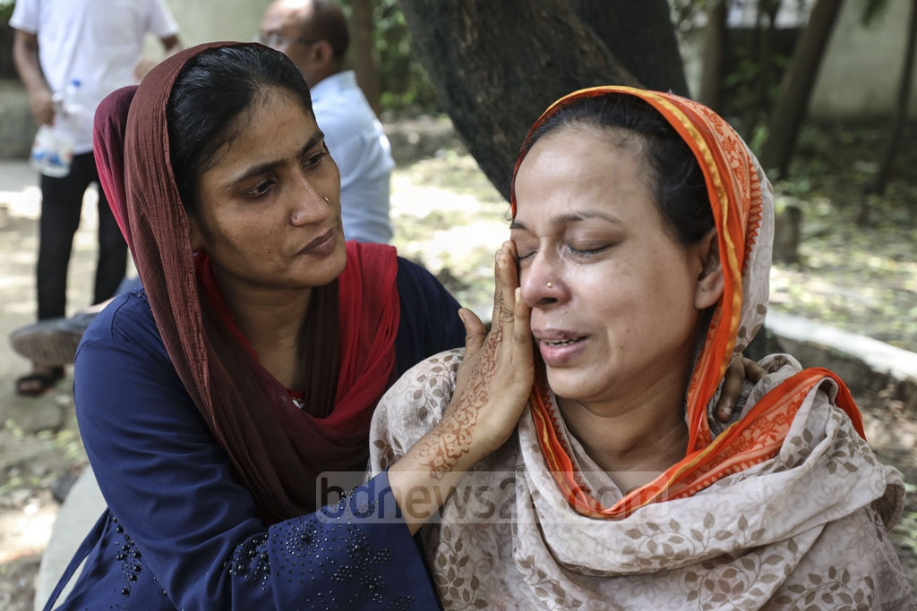 Relatives mourning as housewife 'Jiasmin' died at the Dhaka Medical College Hospital's burns unit after she reportedly set herself on fire following torture by her husband in Munshiganj's Srinagar.
