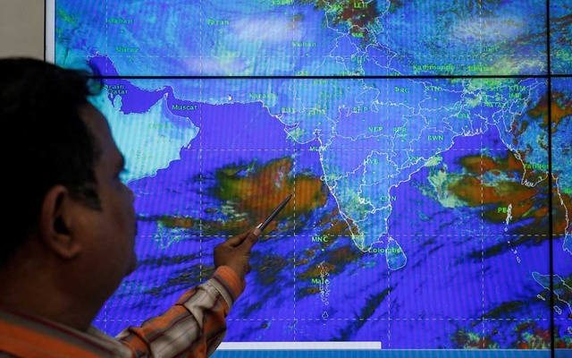 An India Meteorological Department scientist monitors Cyclone Vayu inside his office in Ahmedabad, India, June 11, 2019. REUTERS