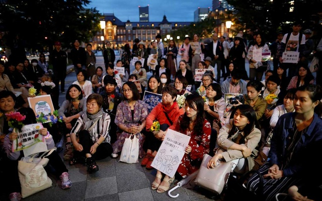 Protesters gather at the rally called 'Flower Demo' to criticise recent acquittals in court cases of alleged rape in Japan and call for revision of the anti-sex crime law, in front of Tokyo Station in Tokyo, Japan Jun 11, 2019. REUTERS