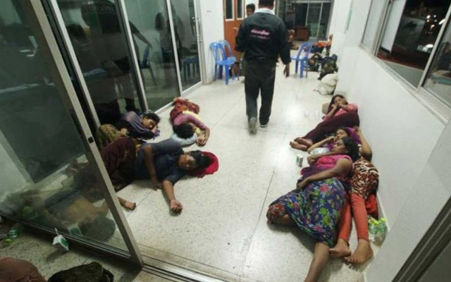 Rohingya people are seen detained in a police station after a fishing boat carrying more than sixty Rohingya refugees was found beached at Rawi island, part of Tarutao national park in the province of Satun, Thailand, bordering with Malaysia, Jun 12, 2019. REUTERS