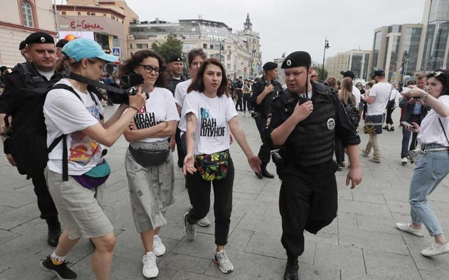 Policemen escort participants of a rally in support of Russian investigative journalist Ivan Golunov, who was detained by police, accused of drug offences and later freed from house arrest, in Moscow, Russia June 12, 2019. REUTERS
