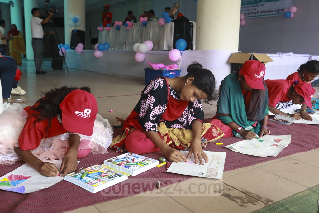 Children painting at a competition organised at the Shilpakala Academy in Dhaka on Wednesday to mark the World Day Against Child Labour.