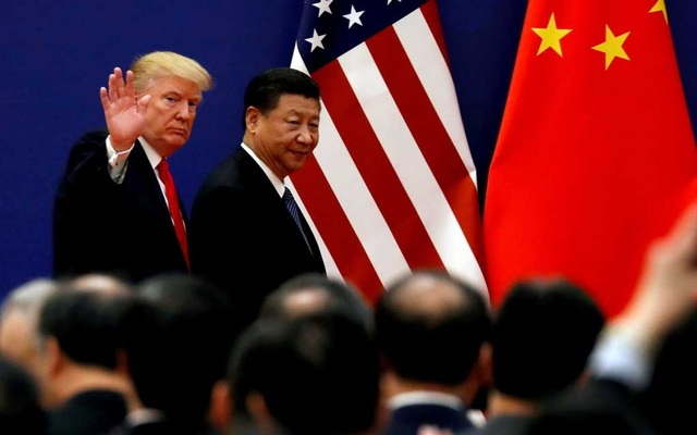 FILE PHOTO: US President Donald Trump and China's President Xi Jinping meet business leaders at the Great Hall of the People in Beijing, China, November 9, 2017. REUTERS
