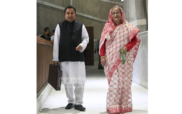 Prime Minister Sheikh Hasina and Finance Minister AHM Mustafa Kamal emerging from a cabinet meeting after signing the approved national budget for fiscal 2019-20 on Thursday. Photo: PID