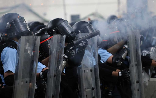 Police officers fire tear gas at protesters during a demonstration against a proposed extradition bill in Hong Kong, China June 12, 2019. REUTERS