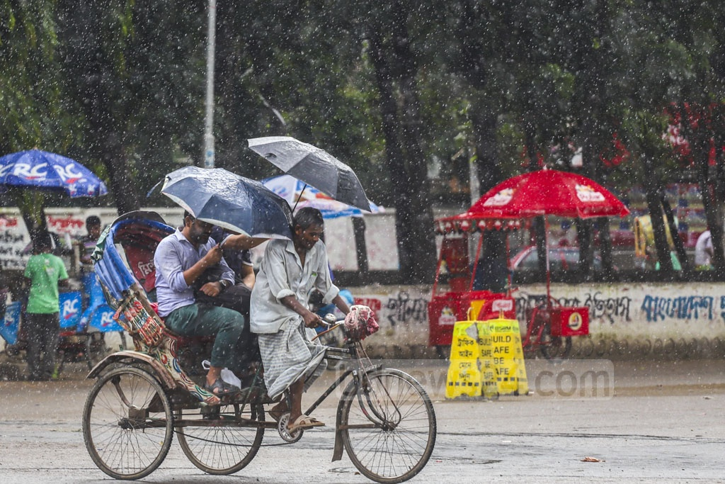 A burst of rain in Dhaka for a couple of hours brought relief for the Dhaka dwellers from the sweltering heat of the past few days. The photo was taken from the Dhaka University campus on Thursday. Photo: Abdullah Al Momin