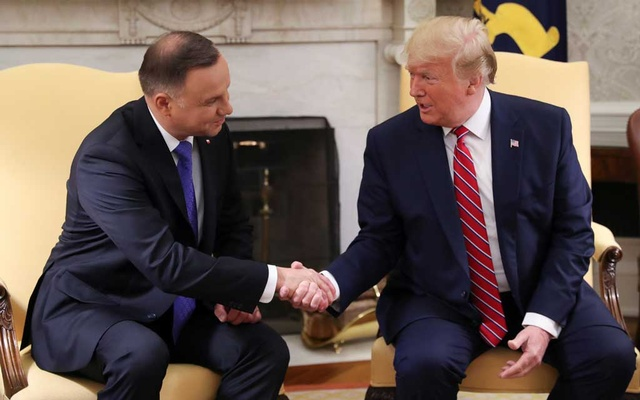 US President Donald Trump greets Poland's President Andrzej Duda in the Oval Office of the White House in Washington, US, June 12, 2019. REUTERS