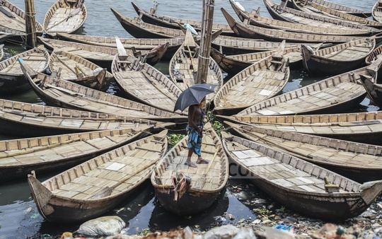 Small wooden boats are Small wooden boats are docked on the Buriganga river bank due to a lack of passengers. This photo was taken at Dhaka's Kamrangirchar on Saturday. Photo: Abdullah Al Momin
