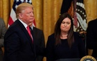 US President Donald Trump brings White House Press Secretary Sarah Sanders onto the stage after it was announced she will leave her job at the end of the month during a second chance hiring prisoner re-entry event, in the East Room of the White House in Washington, US, Jun 13, 2019. REUTERS