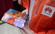 FILE PHOTO: A staff member shows the new Huawei Mate X smartphone with 5G network provided by China Unicom and Huawei at the media centre for the Chinese People's Political Consultative Conference (CPPCC) and the National People's Congress (NPC) in Beijing, China March 1, 2019. Reuters