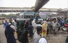 Passengers get on and off a bus in the middle of a street at Mirpur-10 intersection. Photo: Mahmud Zaman Ovi