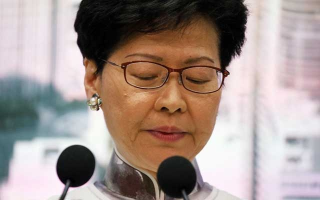 Hong Kong Chief Executive Carrie Lam looks down during a news conference in Hong Kong, China, June 15, 2019. Reuters