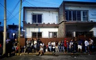 Migrants wait outside the Mexican Commission for Refugee Assistance (COMAR) in Tapachula, Mexico, June 14, 2019. REUTERS
