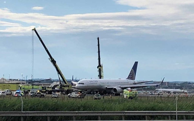 The United Airlines flight 627 plane is pictured disabled on the runway after its tires blew when it landed in New Jersey's Newark airport, US, June 15, 2019. REUTERS