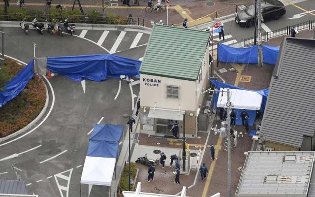 An aerial view shows police officers investigating the site where a police officer was found stabbed in front of a police box and the officer's gun, loaded with several bullets, was stolen, in Suita, Osaka prefecture, western Japan Jun 16, 2019, in this photo taken by Kyodo. Mandatory credit Kyodo/via REUTERS