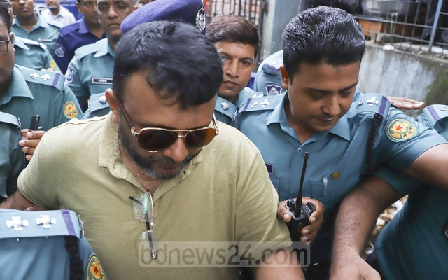 File Photo: Former Sonagazi OC Moazzem Hossain, who was arrested on charges of violating the Digital Security Act in connection with the murder of madrasa student Nusrat Jahan Rafi, appeared before the Bangladesh Cyber Tribunal. Photo: Abdullah Al Momin