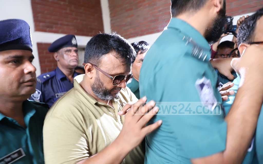 Former Sonagazi OC Moazzem Hossain, who was arrested on charges of violating the Digital Security Act in connection with the murder of madrasa student Nusrat Jahan Rafi, appeared before the Bangladesh Cyber Tribunal on Monday. Photo: Abdullah Al Momin