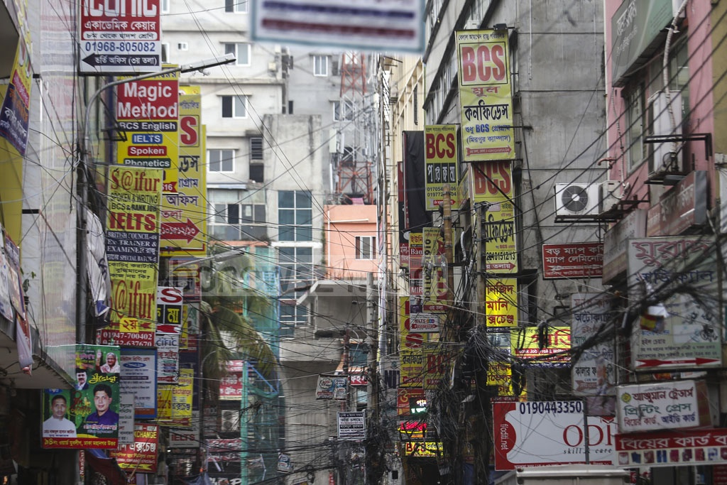 Hundreds of billboards, banners, and festoons for a number of private coaching centre cause a 'visual pollution' at the Mirpur-10 intersection in Dhaka. The photo was taken from a street along the Falpatti or fruit market in the area on Wednesday. Photo: Mahmud Zaman Ovi