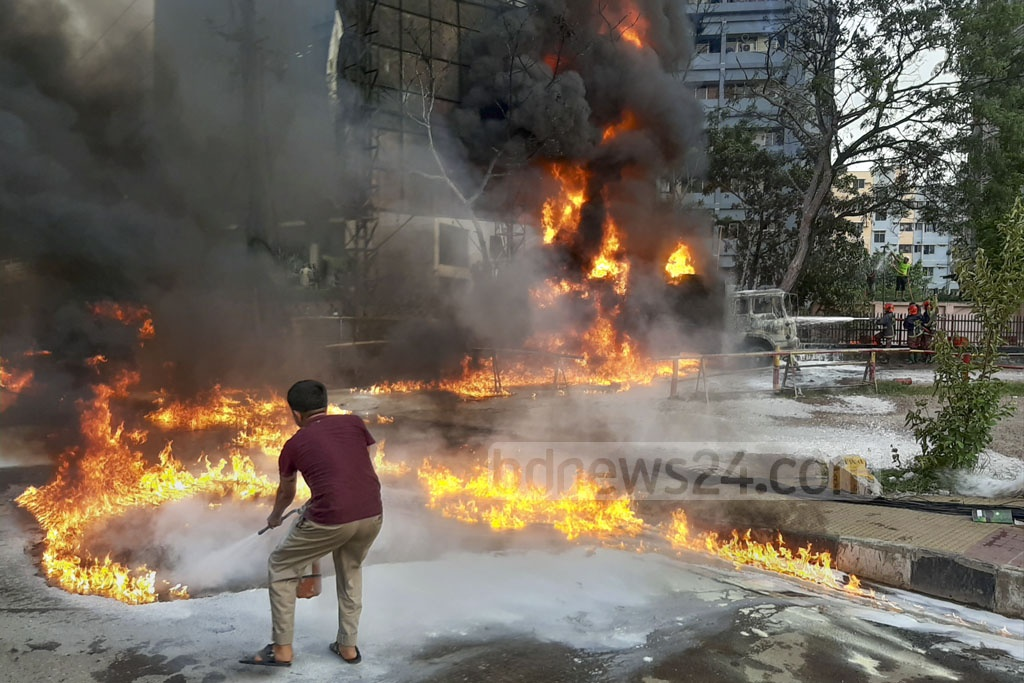 A fire triggered from an oil lorry burnt parts of a filling station and some adjacent buildings at Shyamoli in Dhaka on Tuesday before fire fighters tamed the blaze after about half an hour's battle. Photo: Abdullah Al Momin