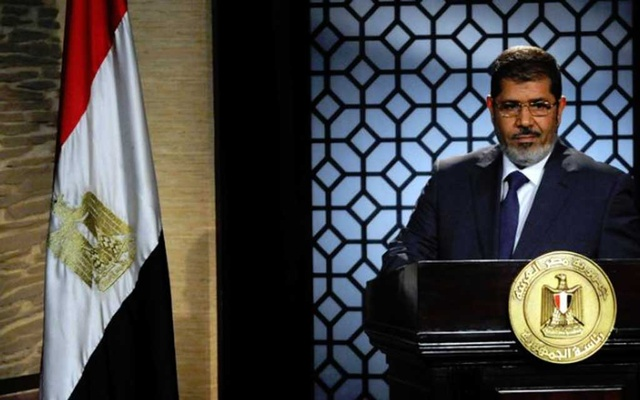 FILE PHOTO - Muslim Brotherhood's president-elect Mohamed Mursi speaks during his first televised address to the nation at the Egyptian Television headquarters in Cairo June 24, 2012. REUTERS