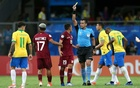 Soccer Football - Copa America Brazil 2019 - Group A - Brazil v Venezuela - Arena Fonte Nova, Salvador, Brazil - Jun 18, 2019 Venezuela's Arquimedes Figuera is shown a yellow card by referee Julio Bascunan REUTERS