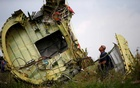 FILE PHOTO: A Malaysian air crash investigator inspects the crash site of Malaysia Airlines Flight MH17, near the village of Hrabove (Grabovo) in Donetsk region, Ukraine, July 22, 2014. REUTERS