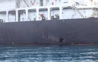 A US military image released by the Pentagon in Washington on June 17 shows what the Navy says is the hull penetration and blast damage on the starboard side of the Japanese owned motor tanker vessel Kokuka Courageous, which was sustained from a June 13 limpet mine attack while operating in the Gulf of Oman and photographed by the US military the following day on June 14, 2019. US Navy handout via Reuters