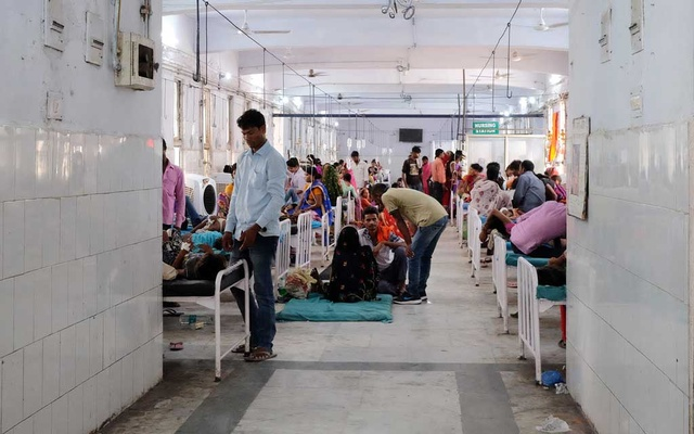 Relatives visit child patients who suffer from acute encephalitis syndrome in a hospital ward in Muzaffarpur, in the eastern state of Bihar, India, June 19, 2019. Reuters