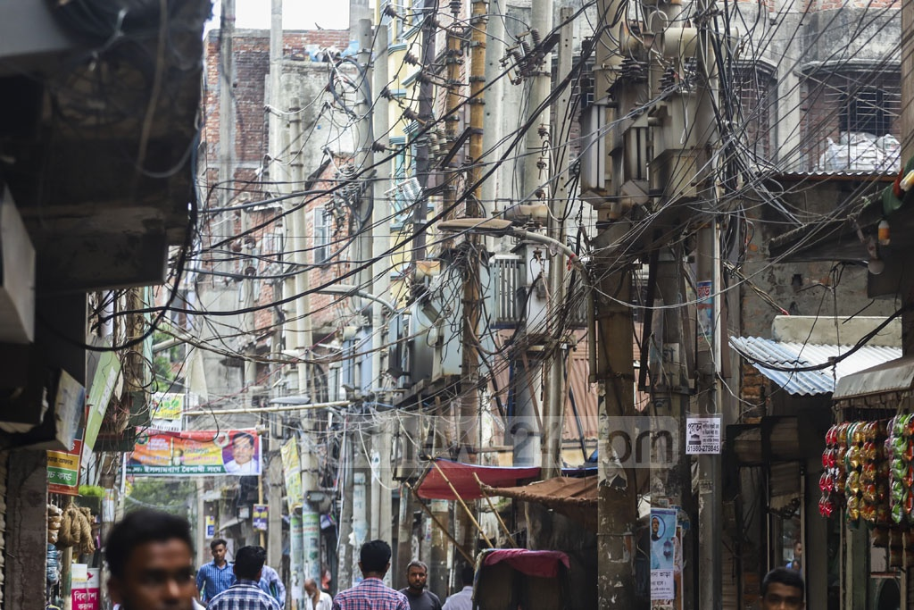 Electricity transformers are installed in precarious positions in Old Dhaka's Islambagh. Photo: Abdullah Al Momin