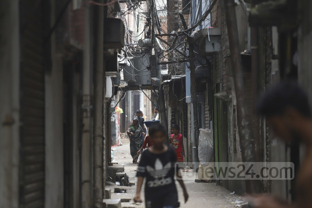 Electricity transformers are installed 10 feet above the ground in a narrow street in Old Dhaka's densely-populated Islambagh. Photo: Abdullah Al Momin