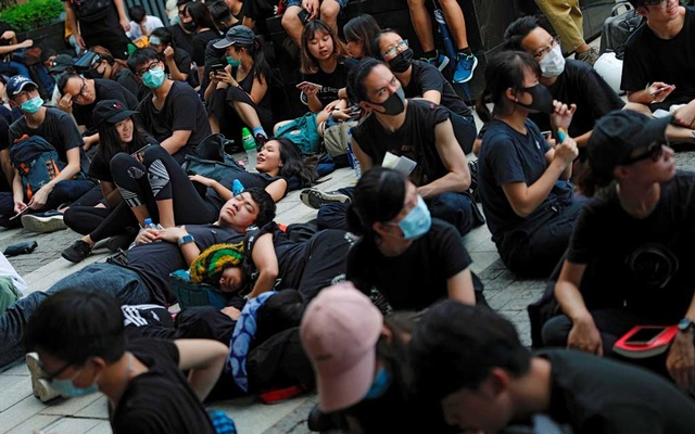 Demonstrators rest outside the Legislative Council building during a demonstration demanding Hong Kong's leaders to step down and withdraw the extradition bill, in Hong Kong, China Jun 21, 2019. REUTERS