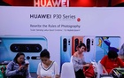 FILE PHOTO:People visit the Huawei stand at the Mobile Expo in Bangkok, Thailand May 31, 2019. Reuters