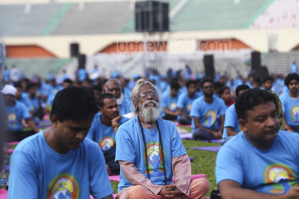 People from various backgrounds join a yoga session at the Bangabandhu National Stadium in Dhaka. Photo: Mahmud Zaman Ovi