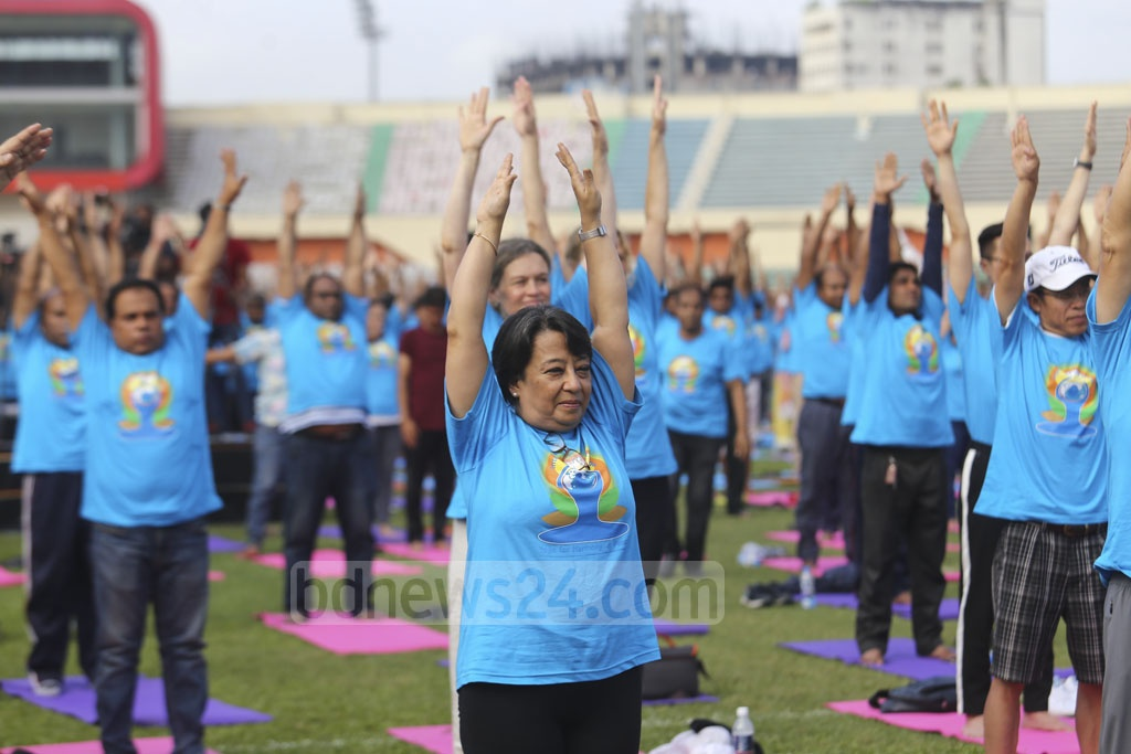 Indian High Commissioner Riva Ganguly Das joins a yoga session at the International Yoga Day celebrations. Photo: Mahmud Zaman Ovi