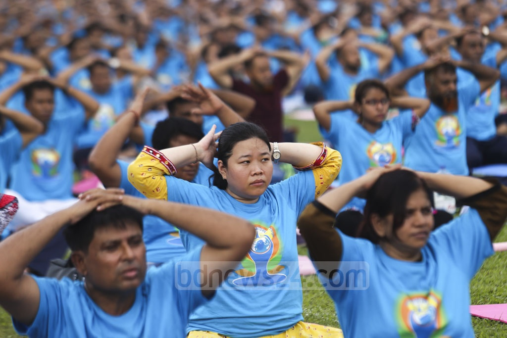 Women along with men join a yoga session at the Bangabandhu National Stadium in Dhaka. Photo: Mahmud Zaman Ovi
