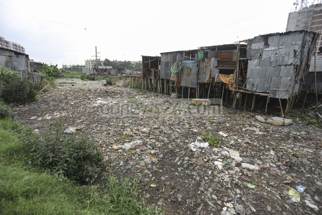 A huge part of the Baganbari canal at Mirpur-14 in Dhaka is clogged with wastes. Photo: Asif Mahmud Ove