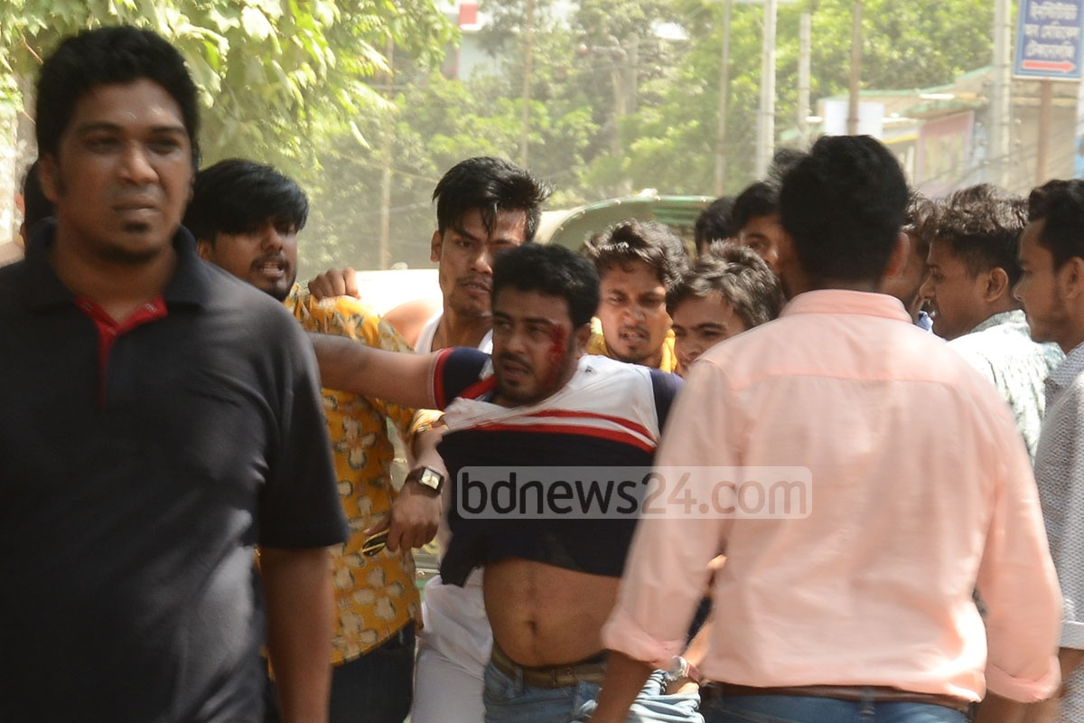 Bangladesh Chhatra League activists handed a member of Islami Chhatra Shibir over to police after beating him up during clashes over the Namaz-e-Janaza of a Jamaat-e-Islami leader at the Chattogram College premises on Saturday. Photo: Suman Babu
