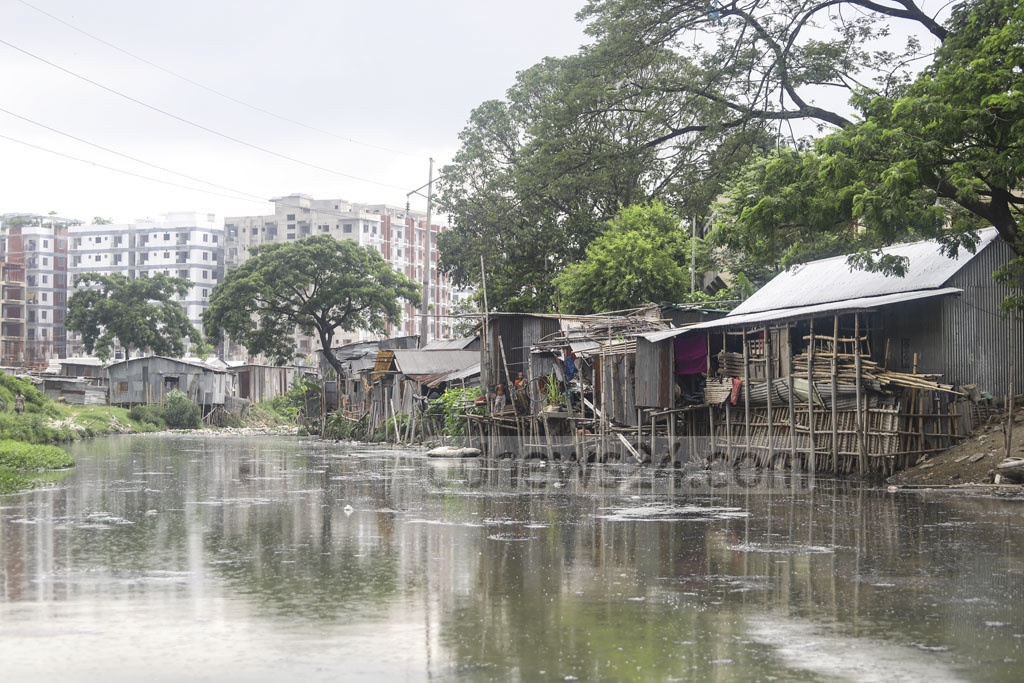 The front part of the Baganbari canal was cleared about a year ago, but the rest of the key water body at Mirpur-14 in Dhaka is still clogged with wastes. Photo: Asif Mahmud Ove